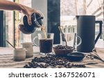 pouring hot coffee | Shutterstock . vector #1367526071