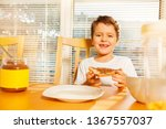 happy boy eating toast with... | Shutterstock . vector #1367557037