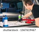 Car chemist. Chemical treatment of the car trunk. - stock photo