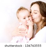 mother and baby. happy family.... | Shutterstock . vector #136763555