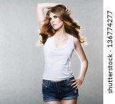 beautiful slim woman with long... | Shutterstock . vector #136774277