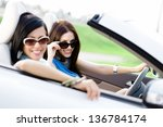 two happy friends in the car... | Shutterstock . vector #136784174