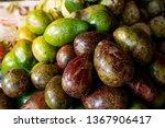 fresh avocado on the market.... | Shutterstock . vector #1367906417