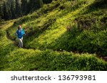Woman On A Trail In The...