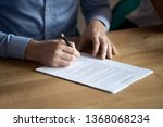 Small photo of Business man manager customer hand sign contract, male client put written signature on legal paper subscribe document fill form make sale purchase commercial insurance deal agreement, close up view