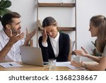 Small photo of Stressed annoyed office employee manager having headache migraine at business meeting with complaining client customer tired of angry colleagues arguing shouting having conflict dispute at workplace