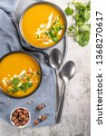 pumpkin soup in bowl garnished... | Shutterstock . vector #1368270617