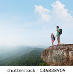 two hikers standing on top of a ... | Shutterstock . vector #136838909