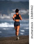 woman jogging on beach | Shutterstock . vector #13684462