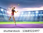 young woman playing tennis in... | Shutterstock . vector #1368522497