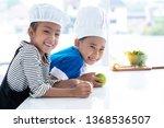 cheerful  little boy and girl... | Shutterstock . vector #1368536507
