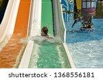 little girl slid down a slide... | Shutterstock . vector #1368556181