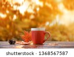 cup of tea with autumn leaves.... | Shutterstock . vector #1368567587