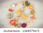 fuits and vegetables  dumbbell... | Shutterstock . vector #1368579671