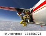 two girls parachutist jumping... | Shutterstock . vector #136866725