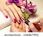 manicure nail paint pink color | Shutterstock . vector #136867901