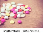many color of pills on wood... | Shutterstock . vector #1368703211