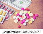 many color of pills and dollars ... | Shutterstock . vector #1368703214