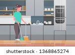 housewife sweeping floor with... | Shutterstock .eps vector #1368865274