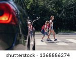 Children next to a car walking...
