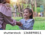asian mom and her daughter have ... | Shutterstock . vector #1368898811