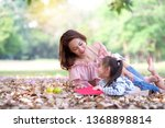 asian mom and her daughter have ... | Shutterstock . vector #1368898814