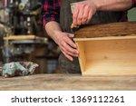 carpenter painting wooden board ... | Shutterstock . vector #1369112261