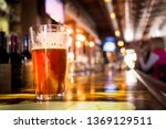 glass pint of amber beer with... | Shutterstock . vector #1369129511