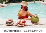 seductive  brunette tan woman...   Shutterstock . vector #1369134404