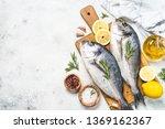 raw dorado fish on cutting... | Shutterstock . vector #1369162367