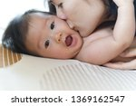 Asian Baby Was Kissed On The...