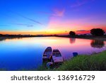 Sunset Over Pond With Two Boats