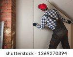 man installing plasterboard... | Shutterstock . vector #1369270394
