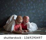 caucasian children in pink t... | Shutterstock . vector #1369290497