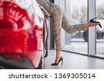 business woman bying a car | Shutterstock . vector #1369305014