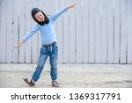 funny child inblue sweater and... | Shutterstock . vector #1369317791