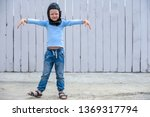 funny child inblue sweater and... | Shutterstock . vector #1369317794