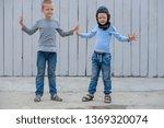 funny children in blue sweater... | Shutterstock . vector #1369320074