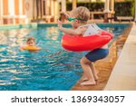 little boy with inflatable... | Shutterstock . vector #1369343057
