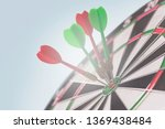 dartboard on a blue background... | Shutterstock . vector #1369438484
