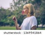 caucasian elder woman smelling... | Shutterstock . vector #1369541864