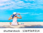 back side of young woman relax... | Shutterstock . vector #1369569314