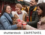 happy friends with cups of... | Shutterstock . vector #1369576451