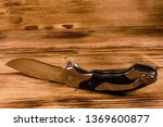opened folding knife on rustic...   Shutterstock . vector #1369600877