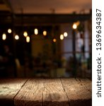 Stock photo blurred background of bar and dark brown desk space of retro wood 1369634387