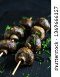 grilled champignons on skewer | Shutterstock . vector #1369666127