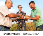 group of farmers standing in a... | Shutterstock . vector #1369673264