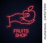 hand hold apple neon sign. male ... | Shutterstock .eps vector #1369673504