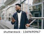 handsome black man in a winter... | Shutterstock . vector #1369690967