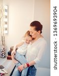 beautiful mother with little...   Shutterstock . vector #1369693904